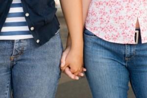 women-holding-hands
