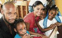 Asafa Powell And Yendi Treats Children For Back To School