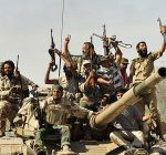 anti-gaddafi-fighters-celebrate-the-fall-of-sirte-pic-reuters-687343115