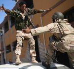 revolutionary-fighters-celebrate-the-capture-of-sirte-pic-ap-274780057