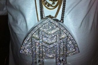 PHOTO: Rick Ross Shows Off Gigantic Maybach Music Group Chain