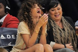 Rihanna Laughs Courtside Lakers Game [Photo]