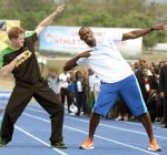 bolt and prince harry on the track