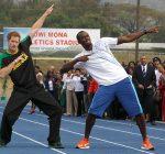 Prince Harry and Usain Bolt pose at the Usain Bolt track, Kingston, Jamaica