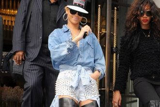 Rihanna Steps Out In Studded Shorts, Thigh-High Boots [Photo]