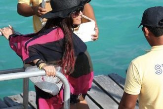 Snooki Shows Off Baby Bump In Cancun [Photo]