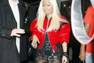 Nicki Minaj Steps Out In Bondage Dress In Britian [Photo]