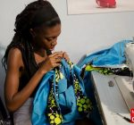 Kesia working on her design in the Singer sewing room