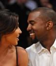 kanye west and Kim Kardashian courtside pda