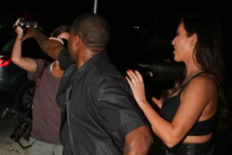 Kanye West Spazzes Out On Paparazzi For Harassing Kim Kardashian [Photo]