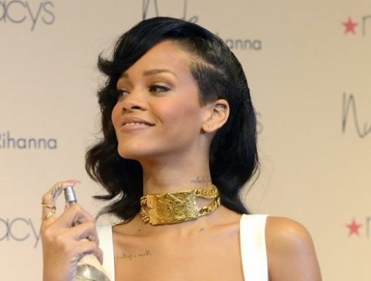 Rihanna looks picture of innocence as she launches new perfume Nude (wearing a Chris Brown