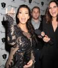 Kim Kardashian rub baby bump