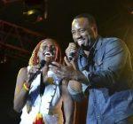 Malik Yoba and Jenny Jenny rebel salute