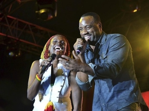 Malik Yoba and Jenny Jenny rebel salute