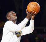 Bolt warms up before the start of the NBA All-Star celebrity basketball game in Houston