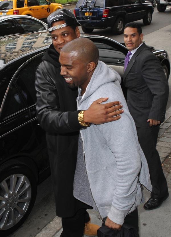 Kanye West and Jay-Z hug