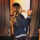 Rihanna drinking wine backstage