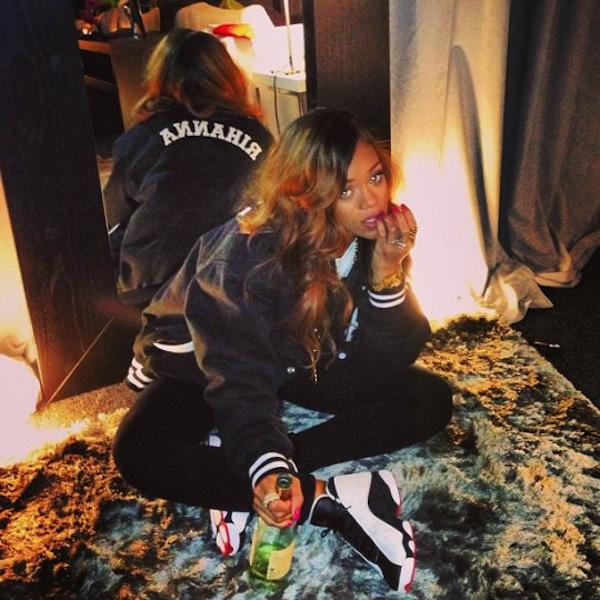 Rihanna with bottle of wine