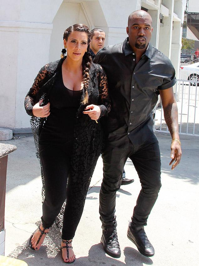Kim and Kanye bump head