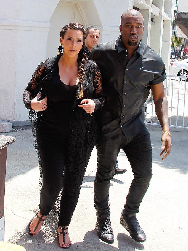 Kim and Kanye bump head