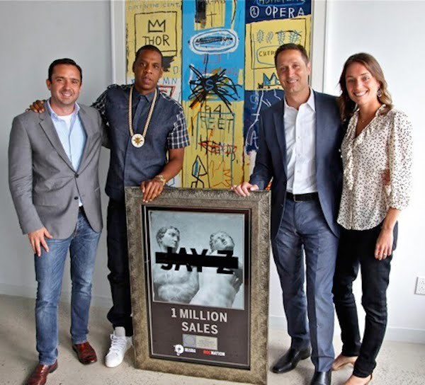 Jay-Z with platinum plaque