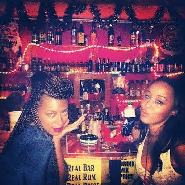 Solange drinking rum in Jamaica