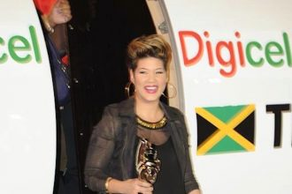 Tessanne Chin Returns Home With Her The Voice Trophy [PHOTO]