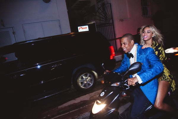 Jay Z and Beyonce on a motorcycle