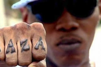 VYBZ KARTEL TRIAL: Video Footage Tattooed Light-Skinned Man With Axe
