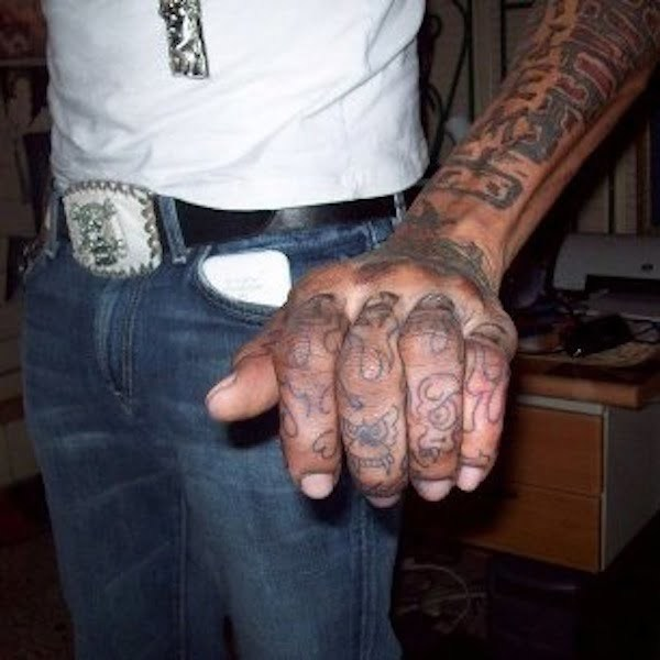 Kartel tattoo hand