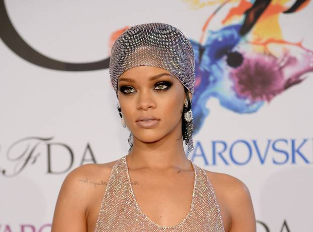 Rihanna Heats Up Barbados Hit Beach In Tiny Bikini [PHOTO]
