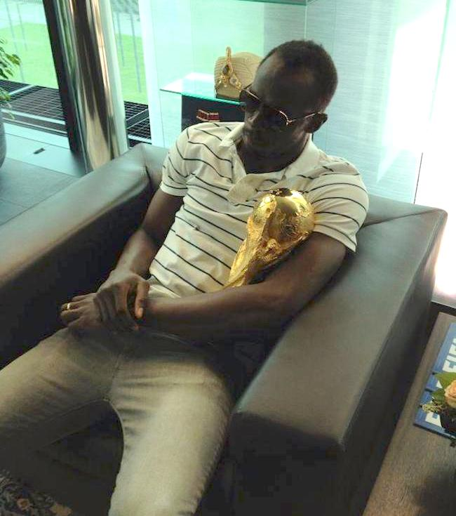 Usain Bolt hold FIFA World Cup