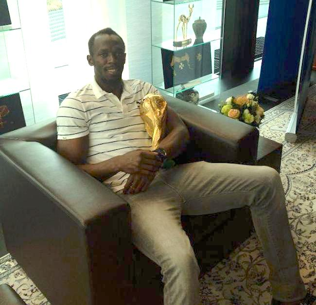 Usain Bolt hold World Cup