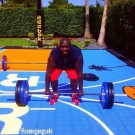 Rick Ross deadlifting