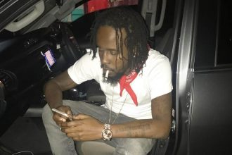 "Watch Popcaan Vs The People ""Jamaica is life Bumbaclat"""