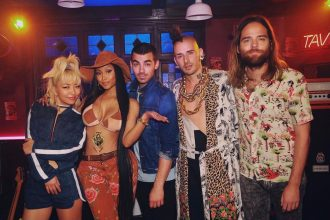 "Nicki Minaj Teases New Song With DNCE ""Kissing Strangers"""
