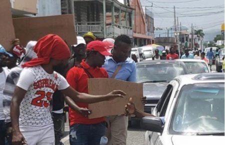Popcaan Leads Protest Over Bad Roads In St. Thomas